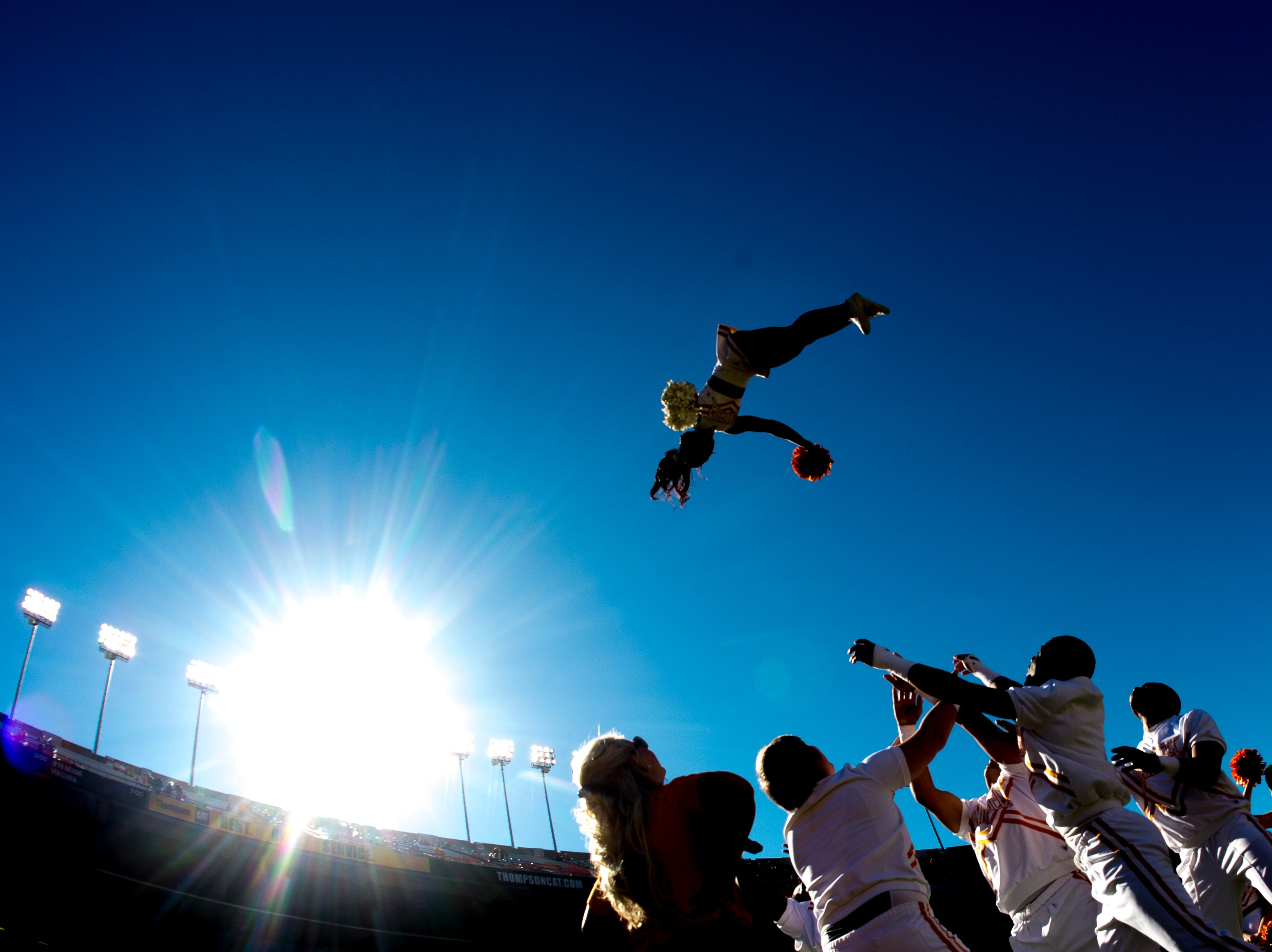 Tennessee cheerleaders perform a stunt during a game between Tennessee and Auburn at Jordan-Hare Stadium in Auburn, Alabama on Saturday, October 13, 2018.