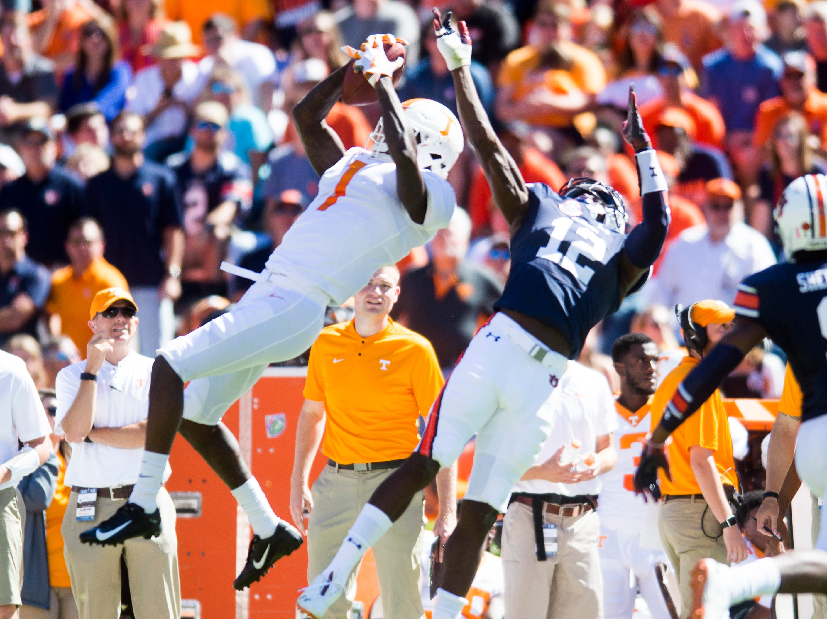 Tennessee wide receiver Marquez Callaway (1) makes a catch as Auburn defensive back Jamel Dean (12) defends during a game between Tennessee and Auburn at Jordan-Hare Stadium in Auburn, Alabama on Saturday, October 13, 2018.