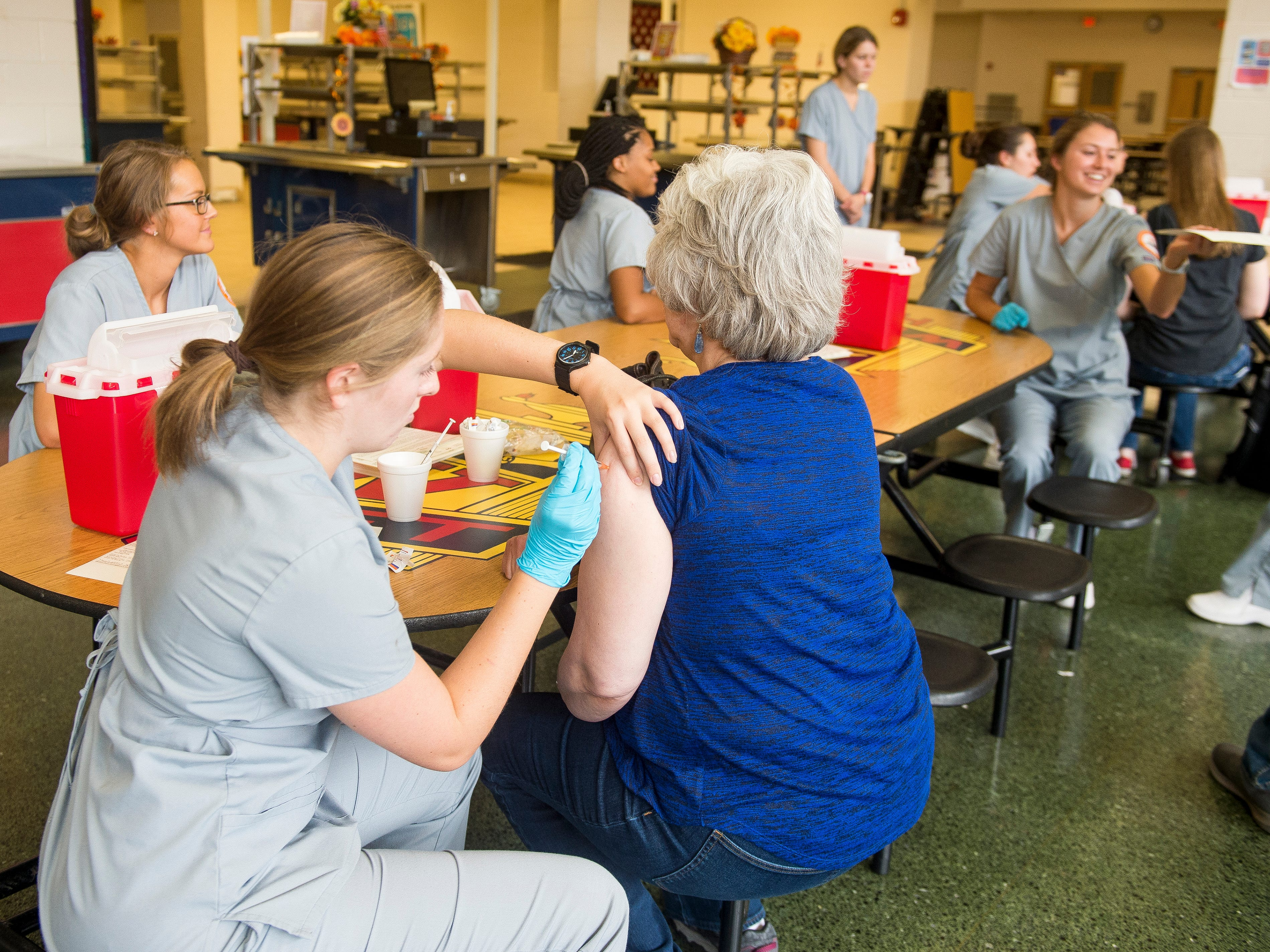 Flu shots are administered at West High School during Free Flu Shot Saturday on Saturday, October 12, 2018.