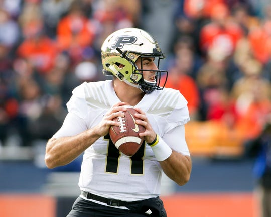 Oct 13, 2018; Champaign, IL, USA; Purdue Boilermakers quarterback David Blough (11) sets up to pass against the Illinois Fighting Illini during the first quarter at Memorial Stadium. Mandatory Credit: Mike Granse-USA TODAY Sports