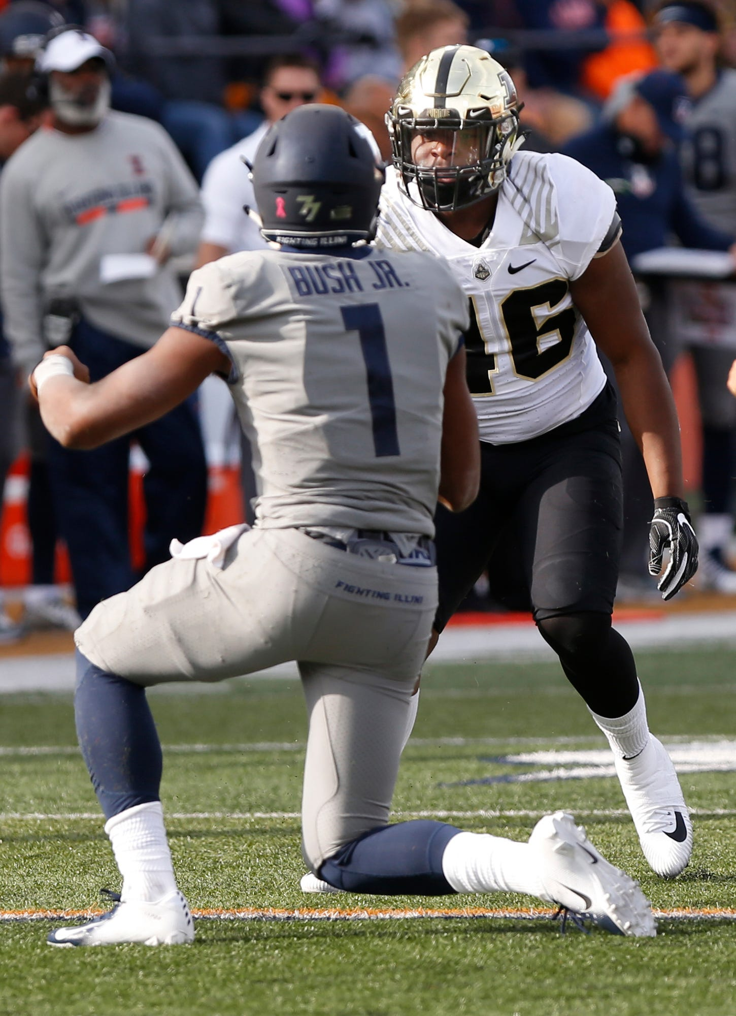 Purdue linebacker Cornel Jones glares at Illinois quarterback AJ Bush Jr. after delivering a hard hit.