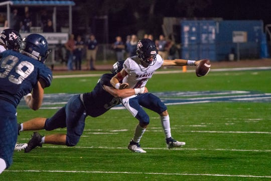 St. Thomas More's defense sacks Teurlings quarterback Sammy LeBlanc during the Cougars' 56-7 win over the Rebels on Friday.
