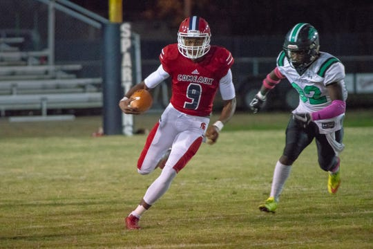 Comeaux's Tre Harris (9) runs the ball as the Spartans play their Homecoming game against the Lafayette High Mighty Lions at Comeaux high school on Oct. 12, 2018.