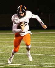 Brighton QB Will Jontz takes off into the open field during Friday night's game vs. Howell.