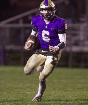 Fowlerville quarterback Geoff Knaggs runs 18 yards for the Gladiators' only touchdown in a 21-7 loss to Lansing Catholic on Friday, Oct. 12, 2018.