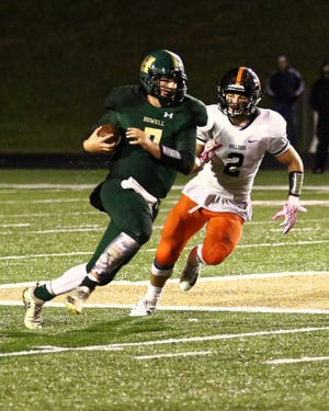 Howell quarterback Matt Hornyak tries to avoid the tackle from Brighton's Zach Pardonnet during Friday night's game.