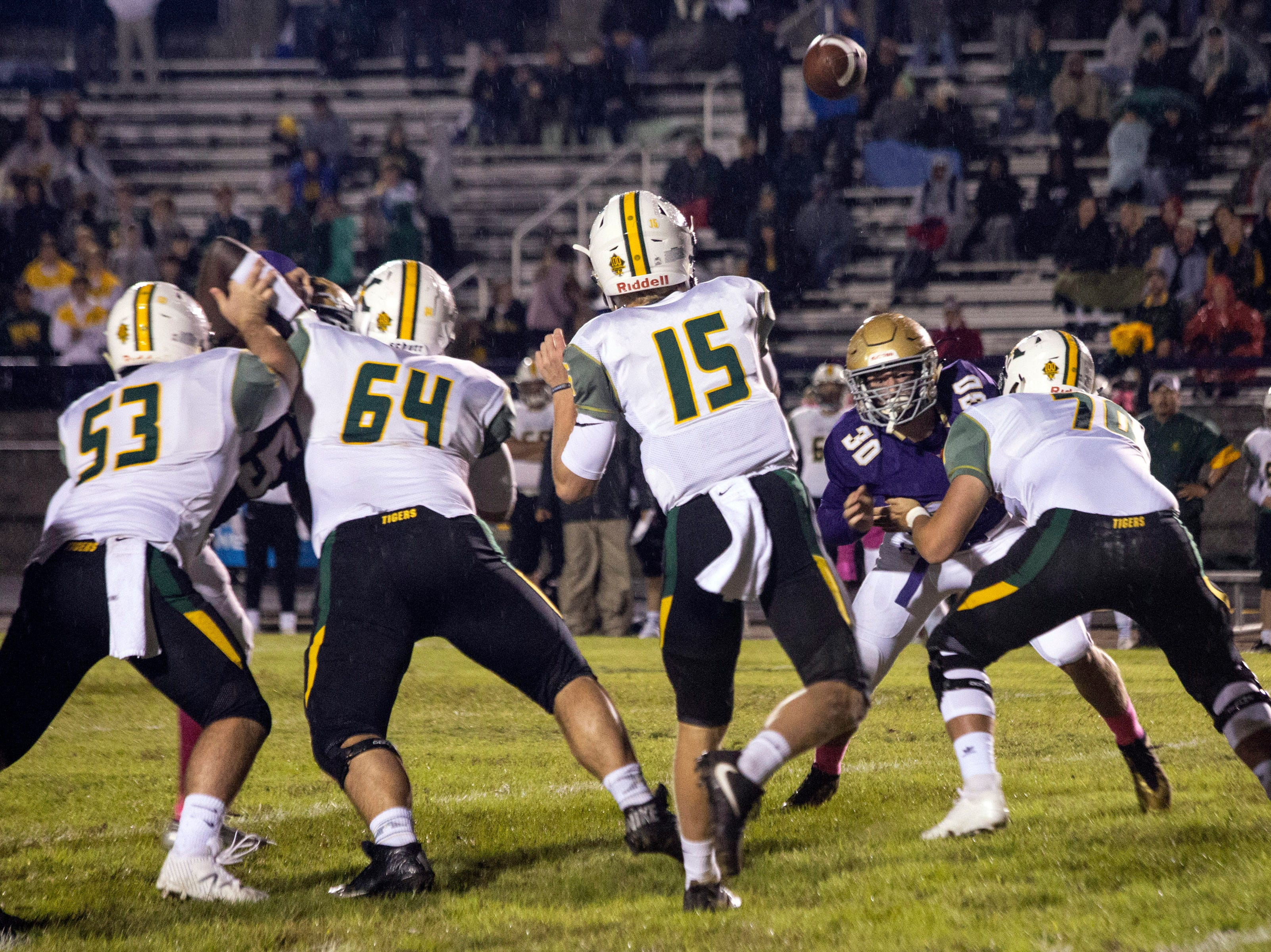 St. X quarterback Douglas Bodhaine lets one fly against the Male defense. Oct. 12, 2018