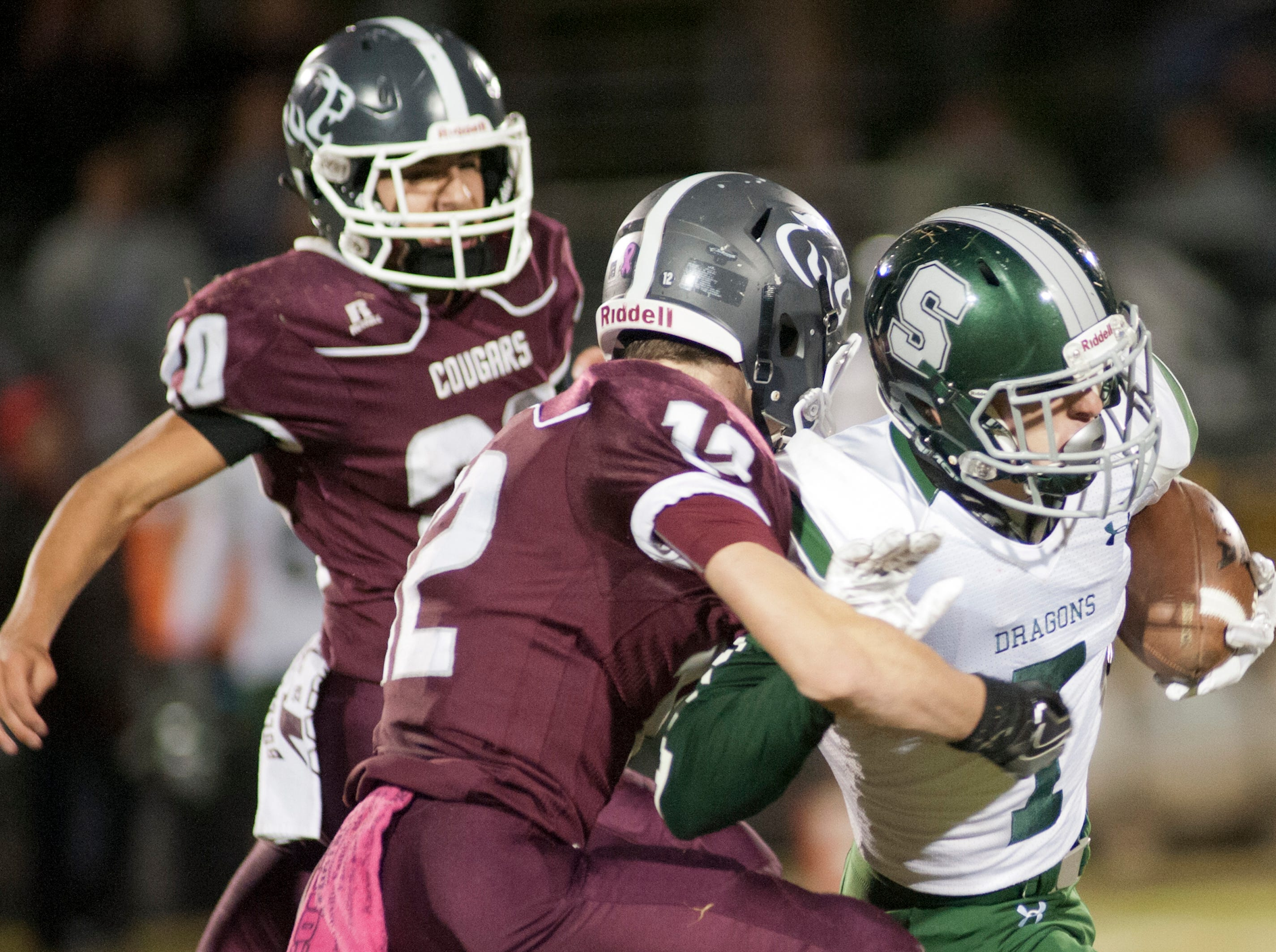 Bullitt Central safety Phillip Hughes has South Oldham wide receiver Ethan Bednarczyk in his grasp. Oct. 12, 2018
