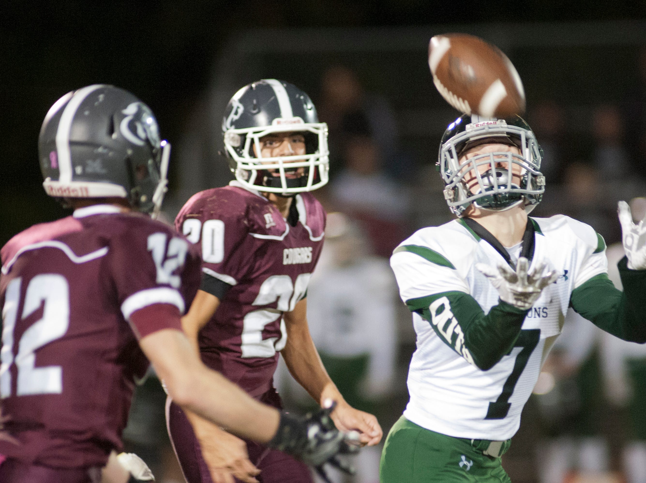 South Oldham wide receiver Ethan Bednarczyk beats Bullitt Central safety Phillip Hughes, left, and Bullitt Central cornerback Jacob Dillman, center, to the ball. Oct. 12, 2018