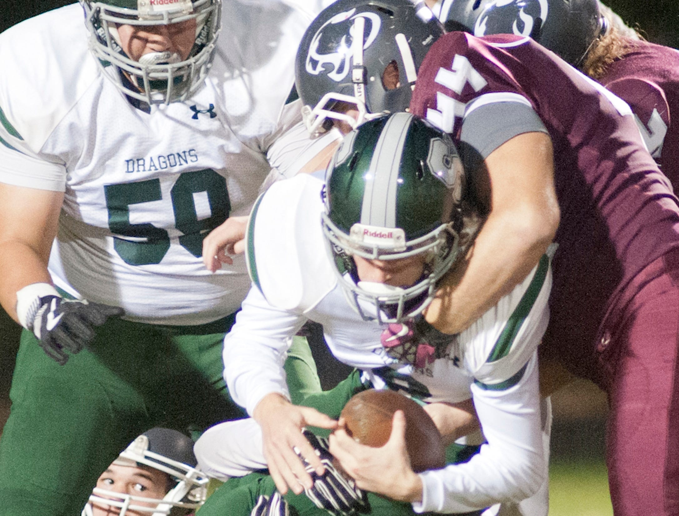 Bullitt Central's Zachary Walker wraps up South Oldham quarterback Anthony Pierce. Oct. 12, 2018