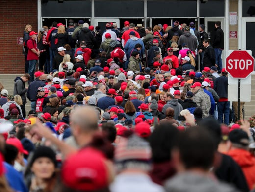 The crowd makes it way to the front doors of Alumni Coliseum to see President Trump at a rally on Eastern Kentucky University.  Oct. 13, 2018