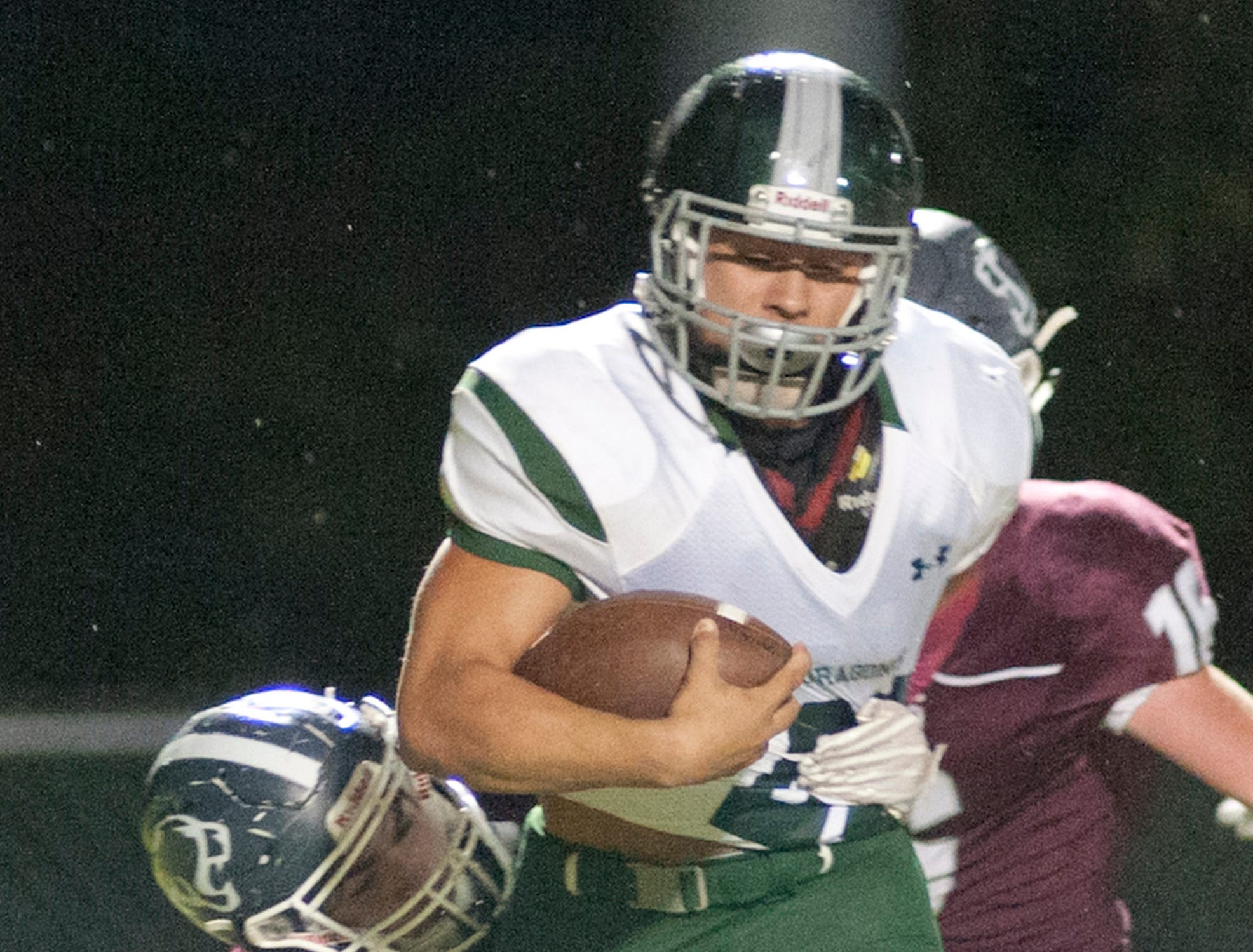 Bullitt Central safety Kylor Close has his arms around the waist of South Oldham running back JT Benson. Oct. 12, 2018