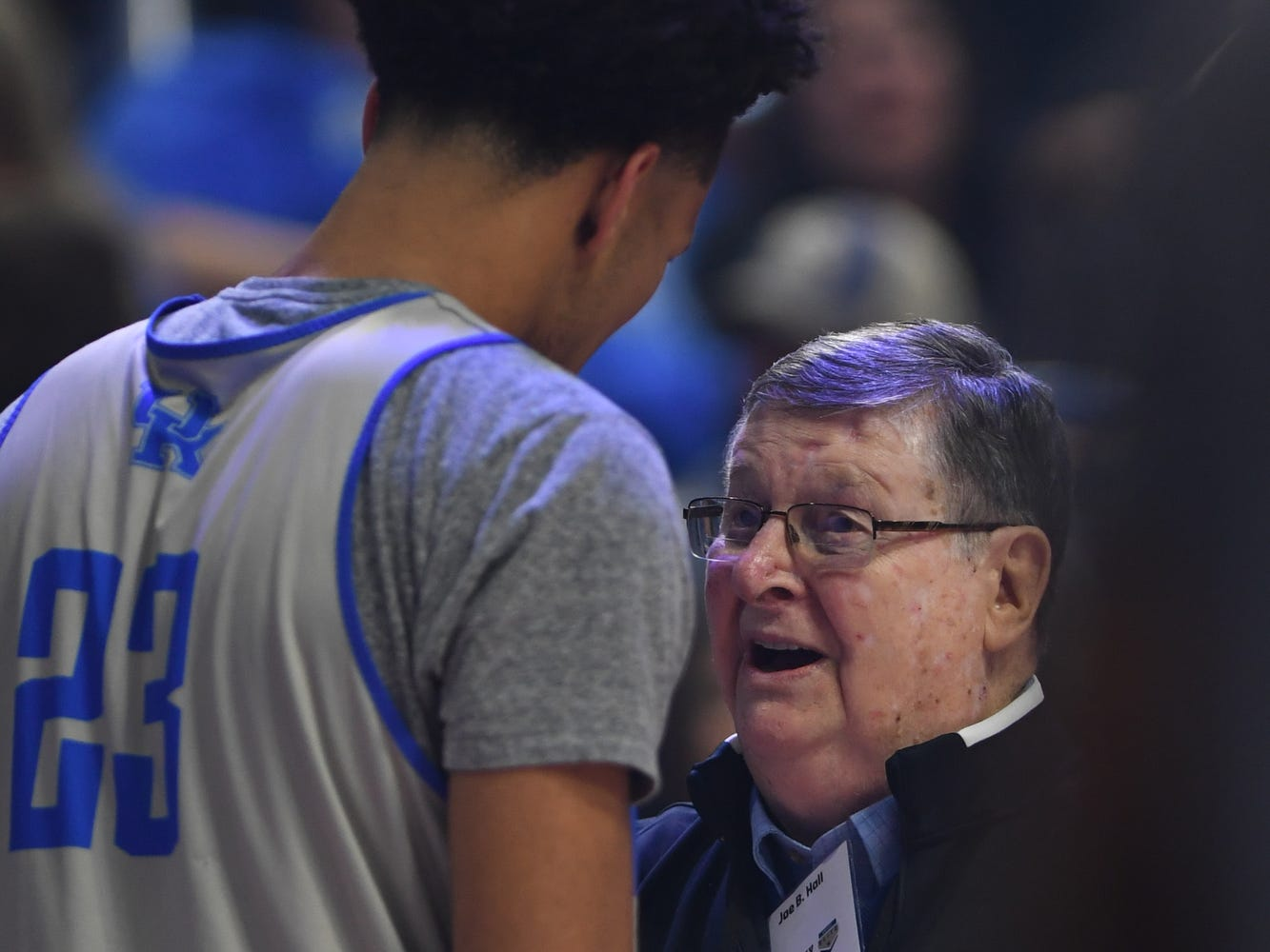 Former player and head coach Joe B. Hall talks to freshman EJ Montgomery during the University of Kentucky basketball's annual Big Blue Madness at Rupp Arena in Lexington, Kentucky on Friday, Oct. 12, 2018.