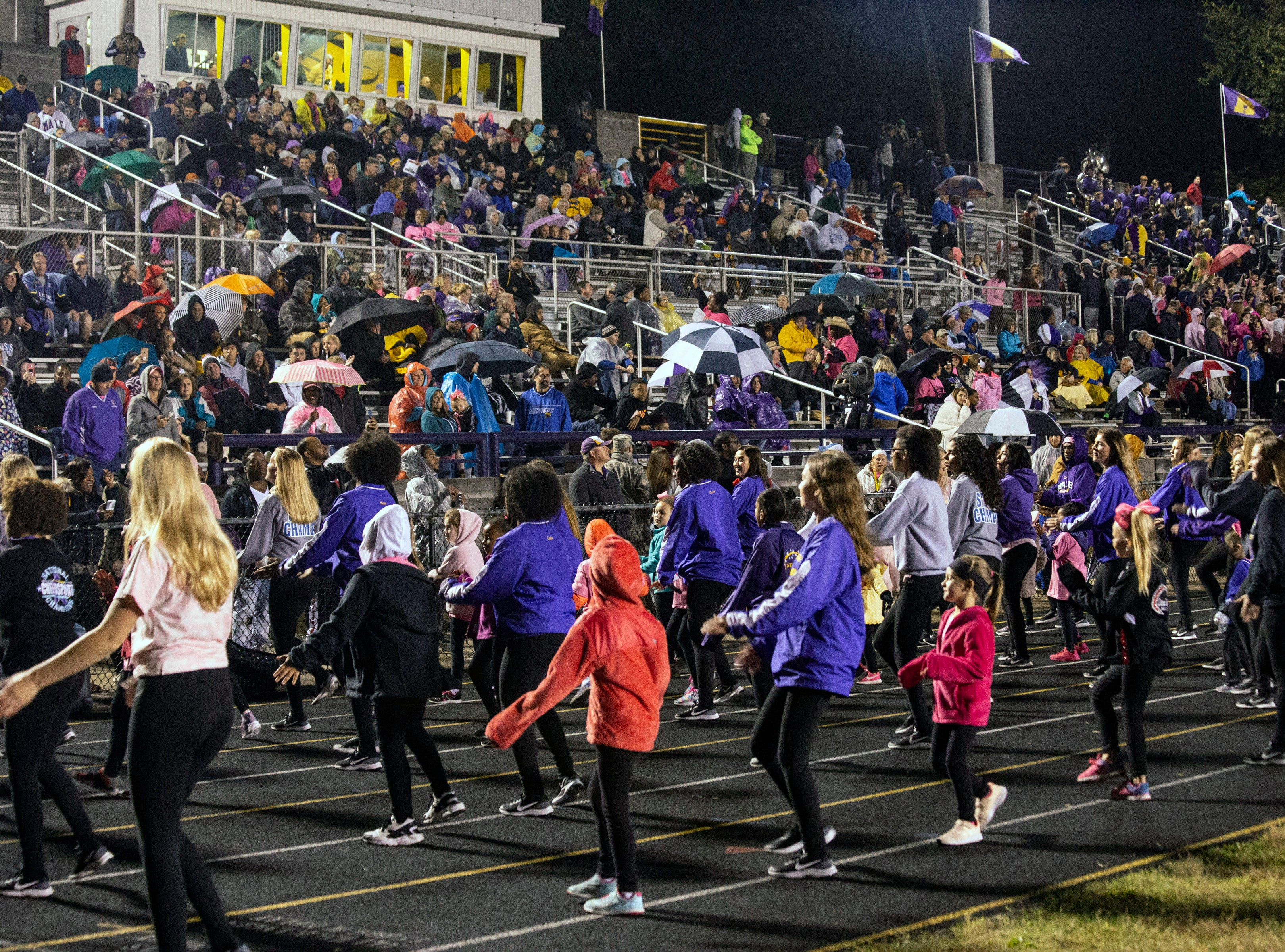The Male dance team had several special guests join them as sideline entertainment against St. X on Friday night. Oct. 12, 2018