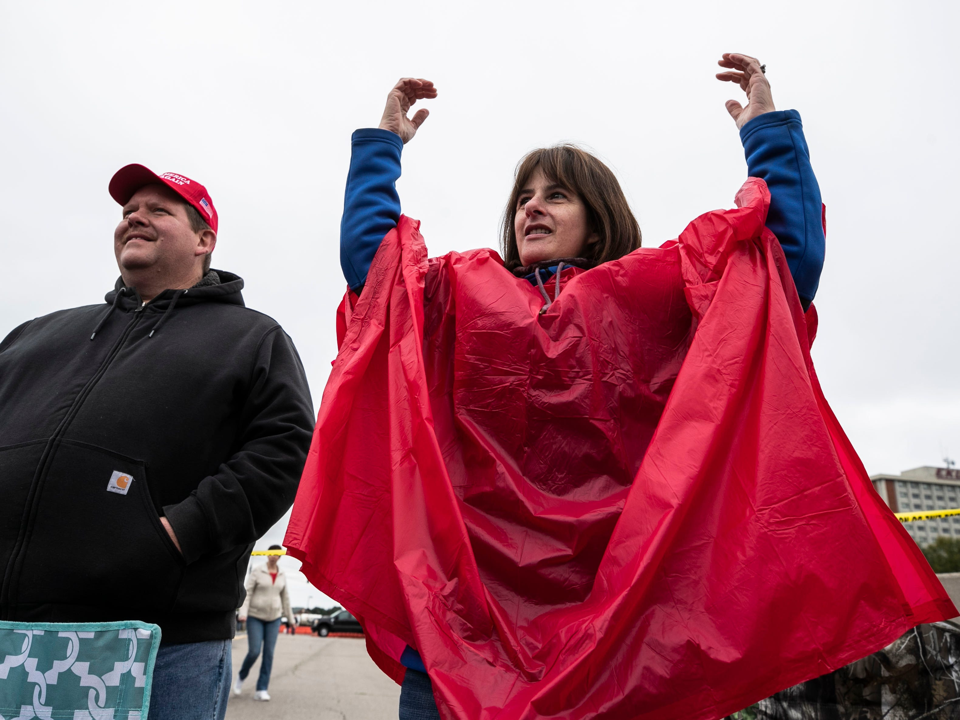 Trump supporter Angela Ward of Chicago dances to the Village People's 'YMCA' as it played on the loudspeakers in a parking lot outside the Alumni Coliseum. Hundreds of people were lined up to see the President.