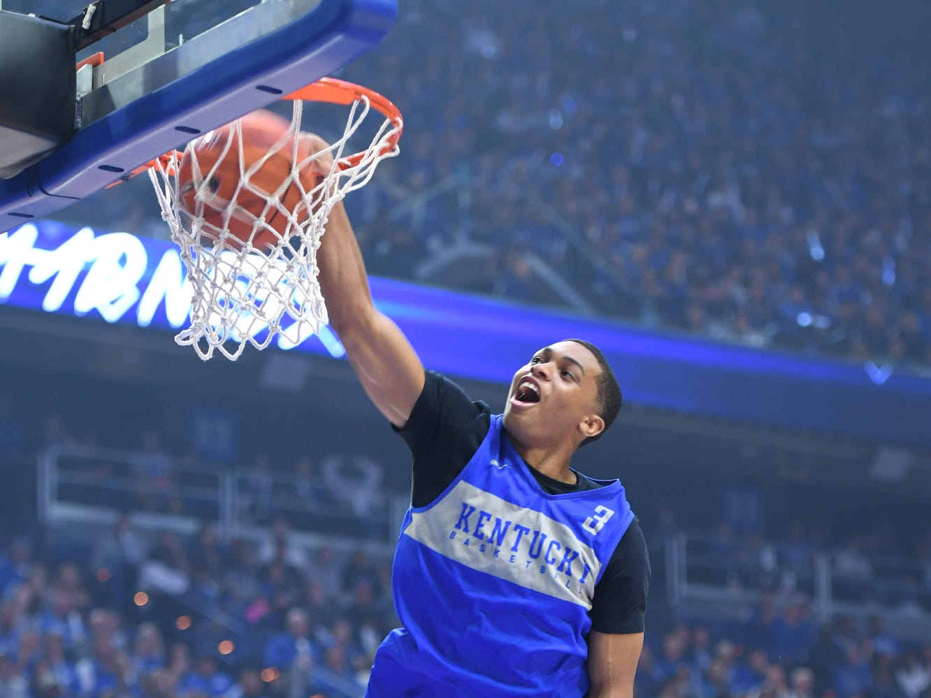 Freshman Keldon Johnson dunks over two people during the University of Kentucky basketball's annual Big Blue Madness at Rupp Arena in Lexington, Kentucky on Friday, Oct. 12, 2018.