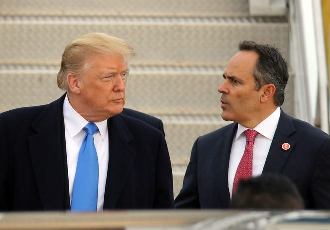 Gov. Bevin, right, and President Trump, left, talk near Air Force One at Bluegrass Airport in Lexington, Oct. 13, 2018.