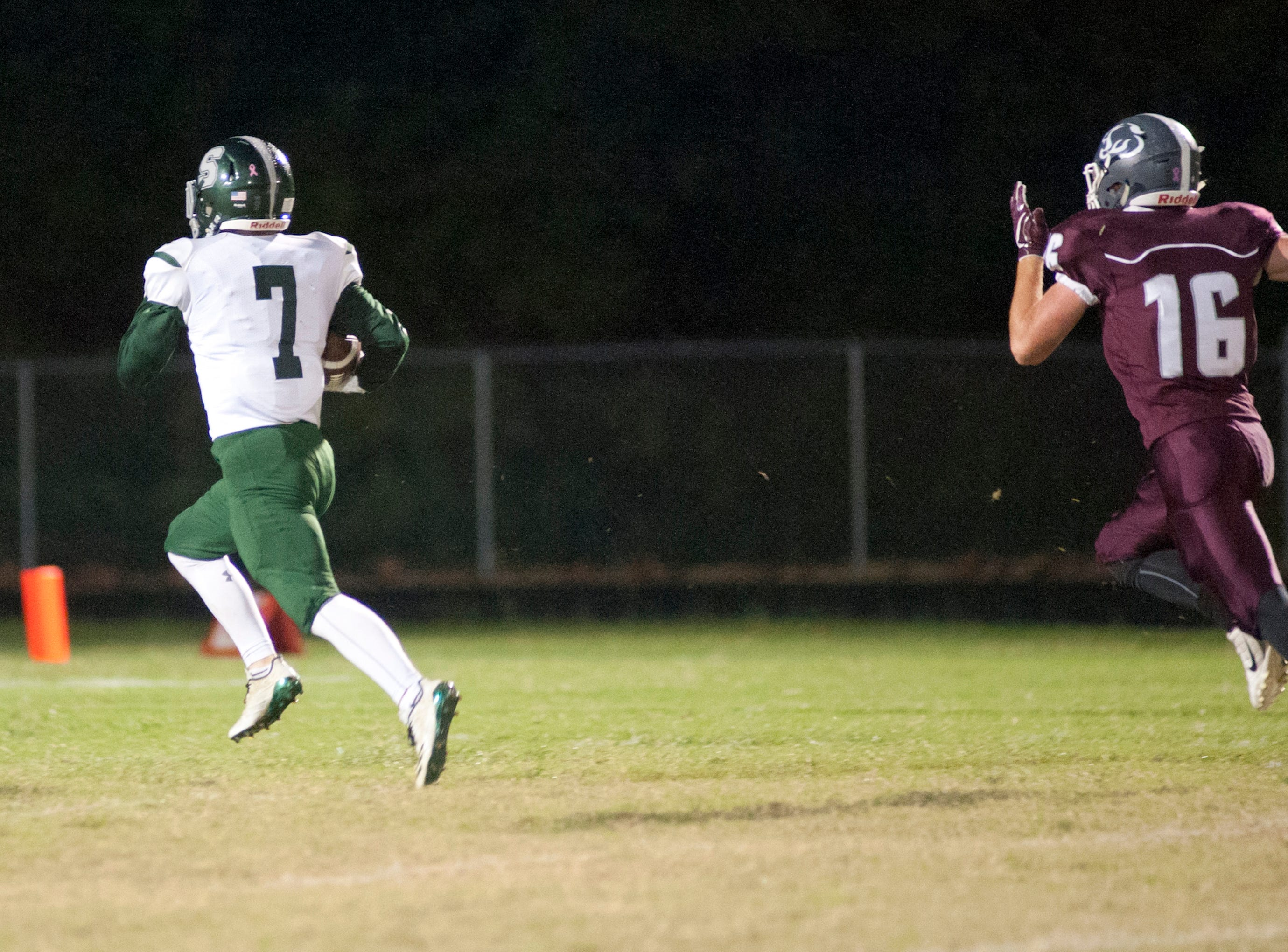 Bullitt Central cornerback Timothy Heilman can't catch South Oldham wide receiver Ethan Bednarczyk, who scores the first touchdown of the game. Oct. 12, 2018