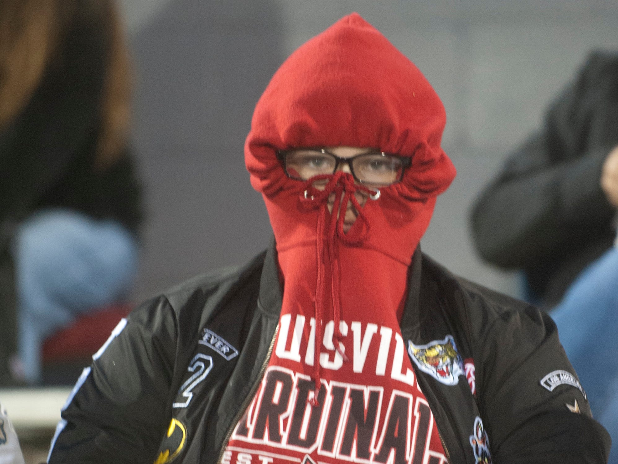 A Bullitt Central fan is bundled up for the 40 degree weather during the game. Oct. 12, 2018