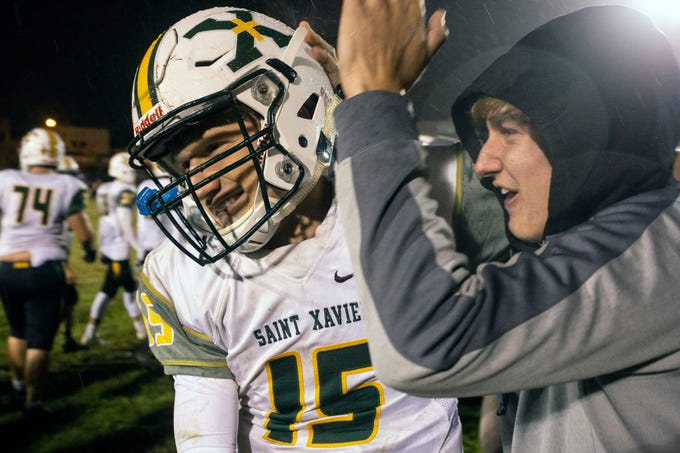 St. X quarterback Douglas Bodhaine is celebrated as he comes off the field with a defeat of previously unbeaten No. 1 team Male on Friday night. Oct. 12, 2018