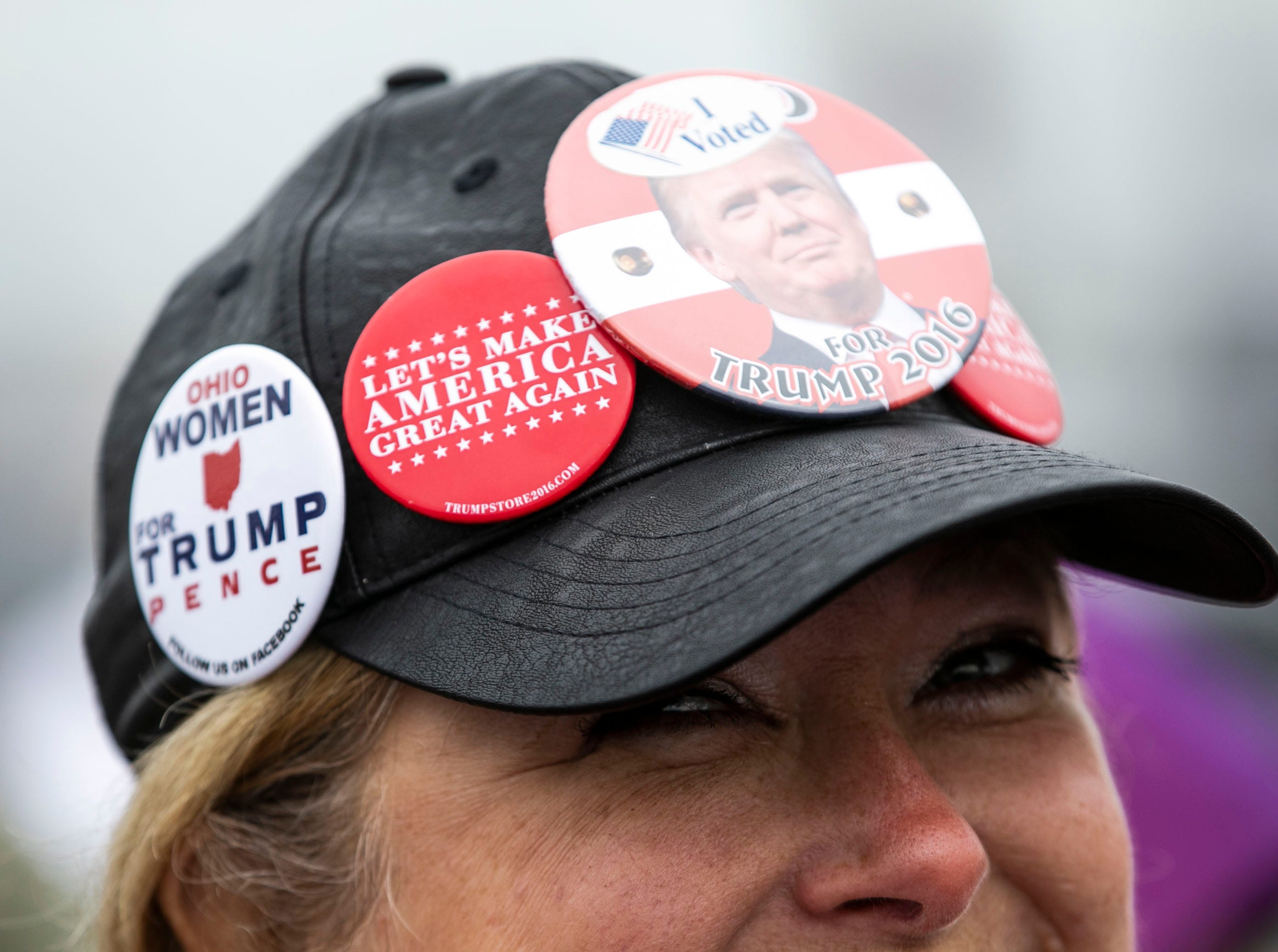 All sorts of Donald Trump buttons were worn by women and men -- as well as buttons against former opponent Hilary Clinton -- while waiting in a parking lot outside the Alumni Coliseum for the speech of President Donald Trump later Saturday night.
