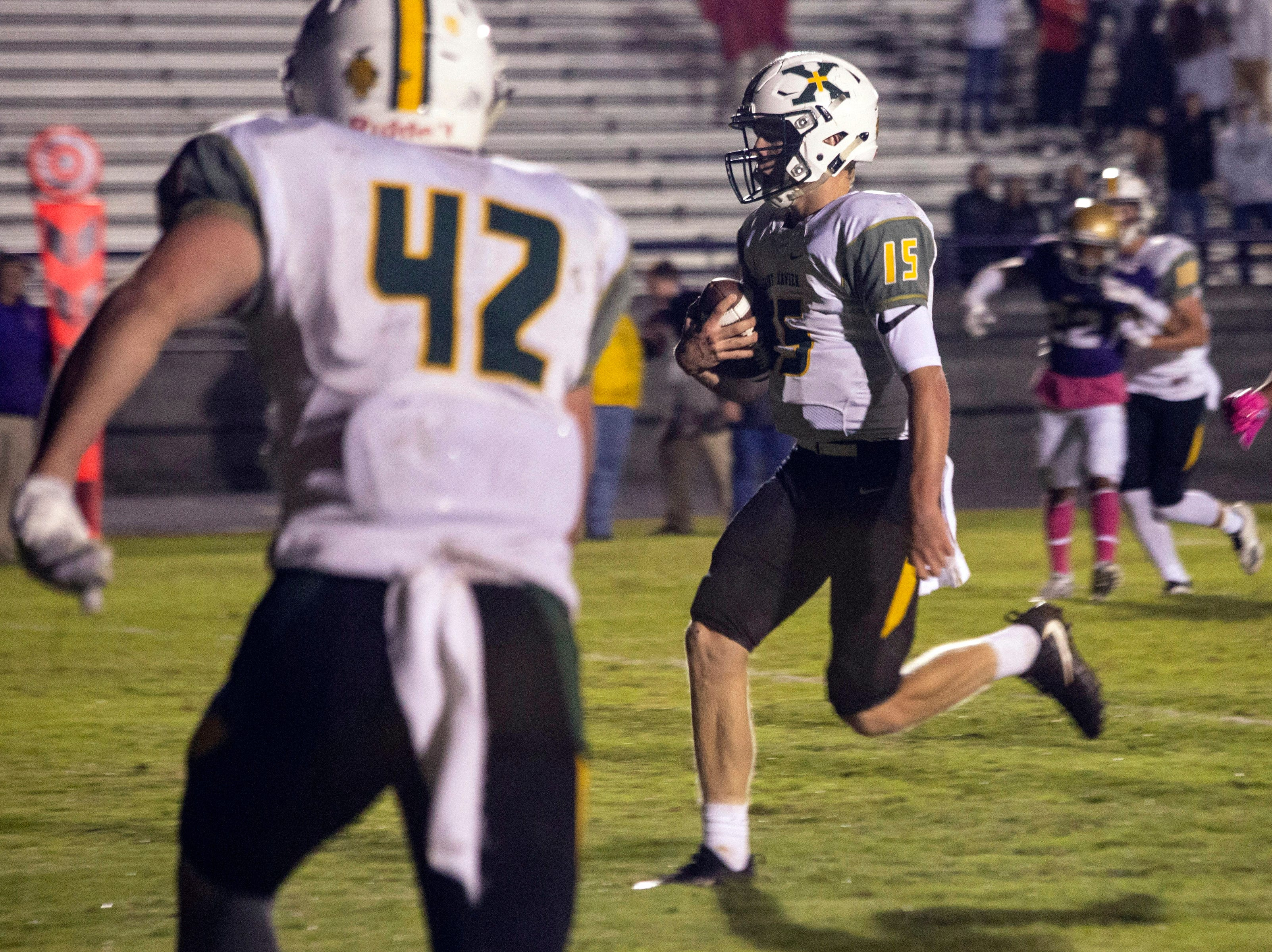 St. X quarterback Douglas Bodhaine runs in an easy touchdown against Male on Friday. Oct. 12, 2018