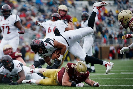 Boston College linebacker Connor Strachan, bottom, stops Louisville running back Trey Smith (12) short of the goal line during the first half of an NCAA college football game in Boston, Saturday, Oct. 13, 2018.