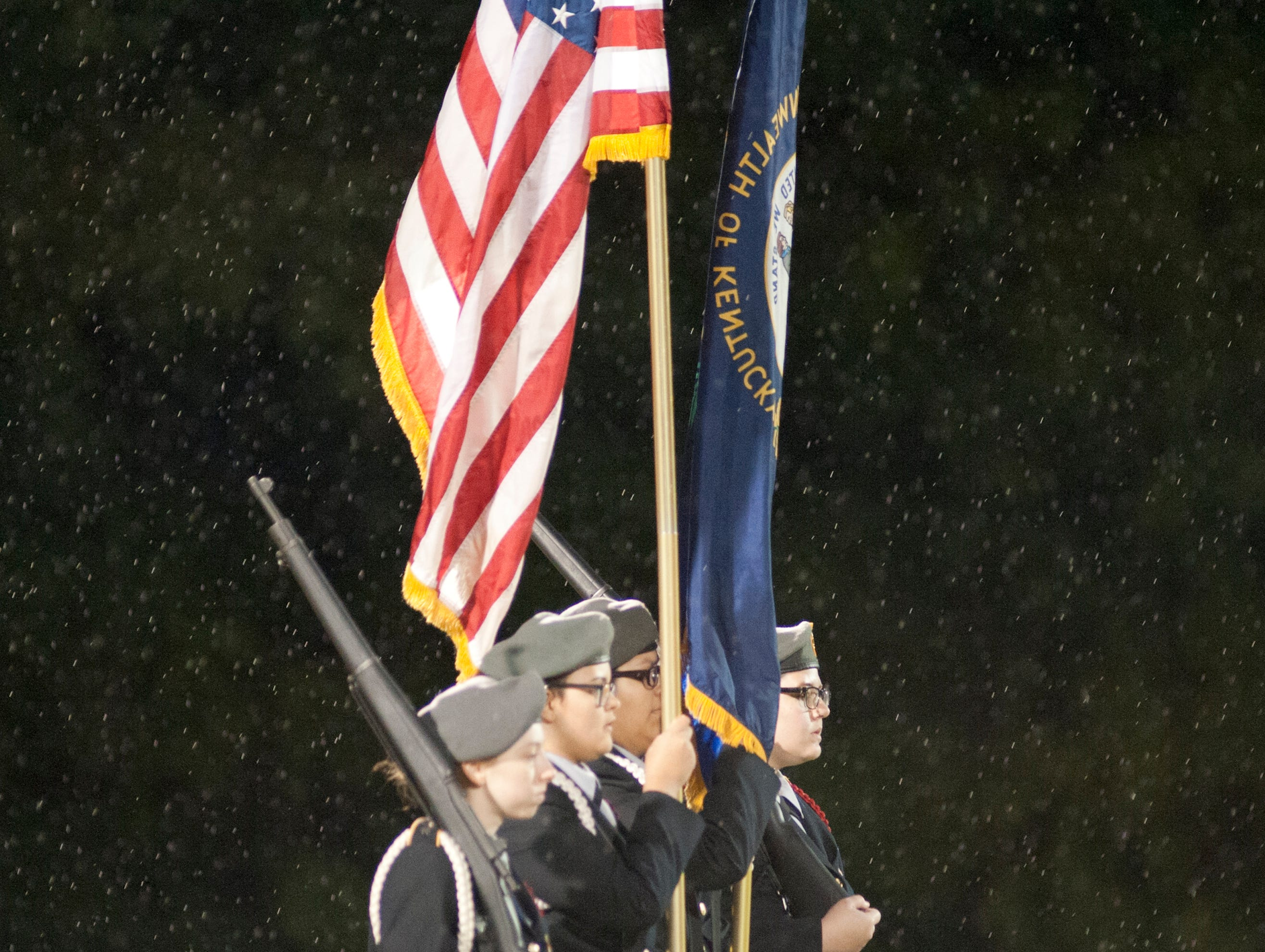 The Bullitt Central Junior Army ROTC honor guard marches onto the field in the pouring rain. Oct. 12, 2018