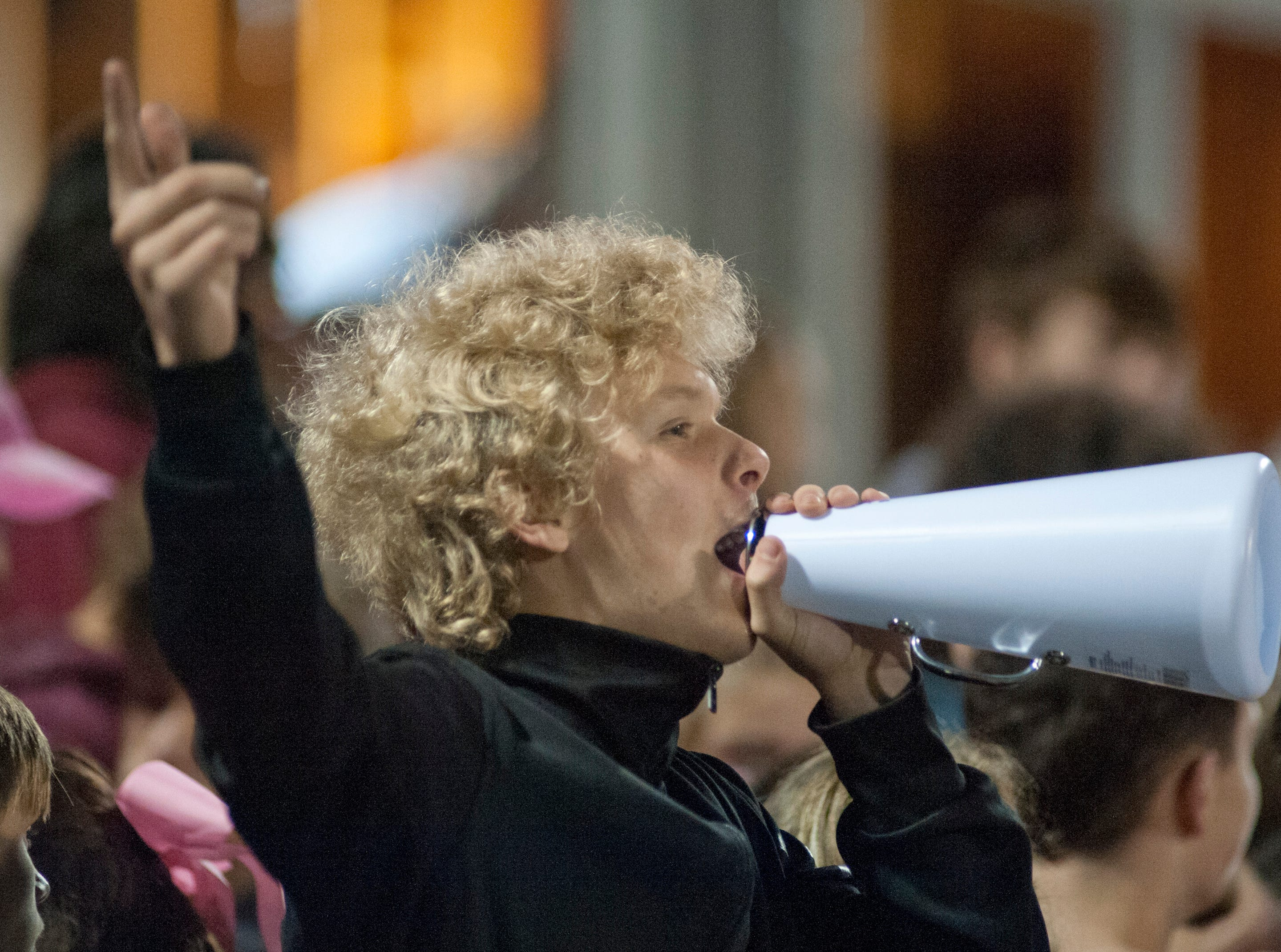 A Bullitt Central fan yells through a megaphone from the stands. Oct. 12, 2018