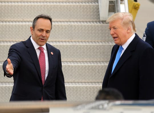 Gov. Bevin introduces an unseen individual to President Trump near Air Force One at Bluegrass Airport in Lexington, Oct. 13, 2018.