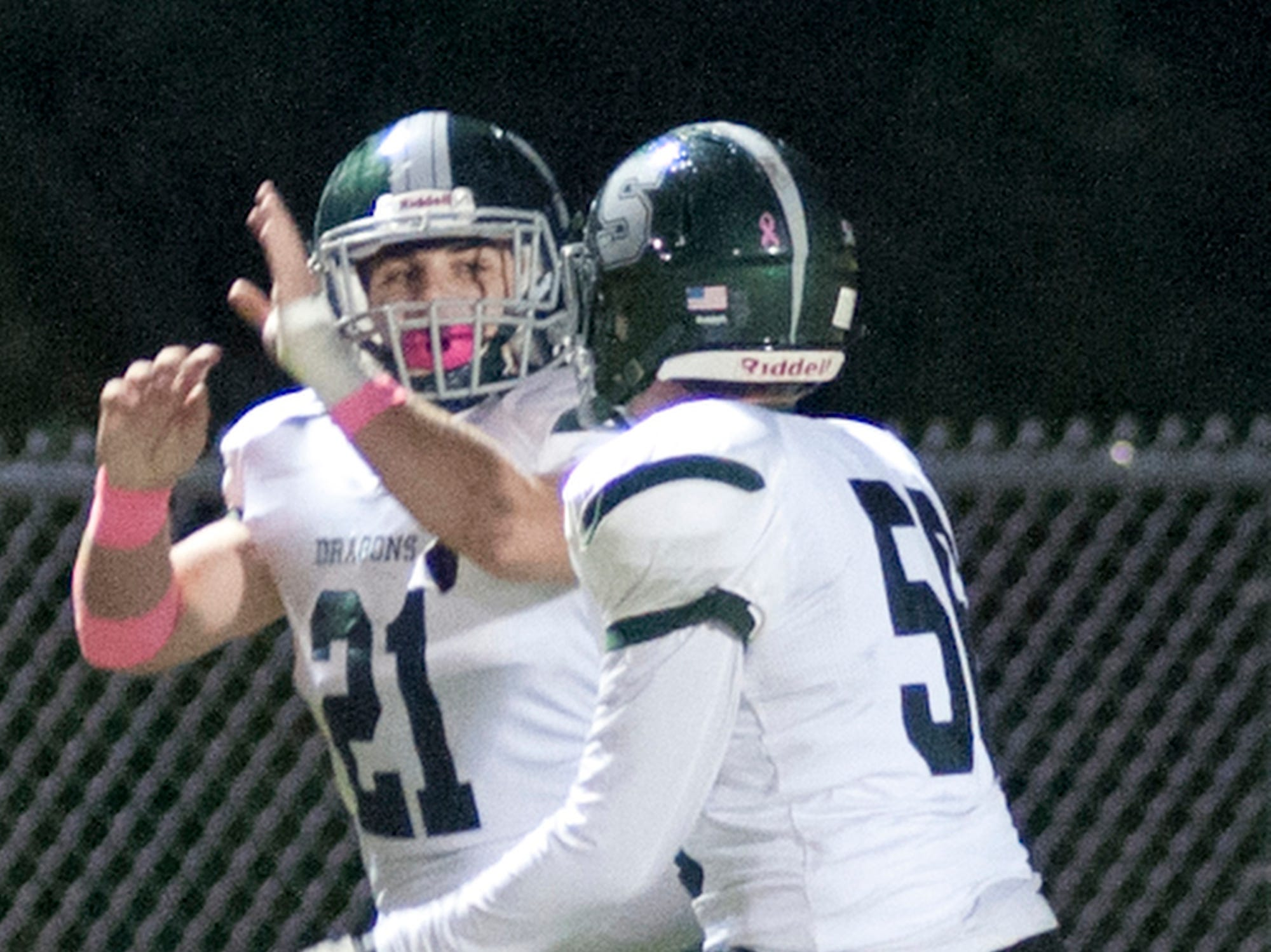 After scoring a touchdown, South Oldham running back Keaton Martin slaps hands with a teammate. Oct. 12, 2018