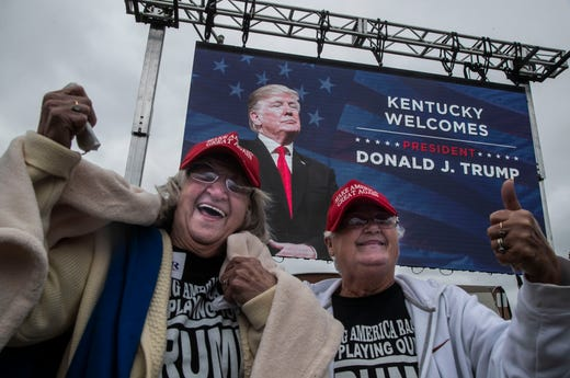 A large video screen flashed the image of President Donald Trump to the delight of supporters as they waited in a parking lot outside the Alumni Coliseum Saturday afternoon.