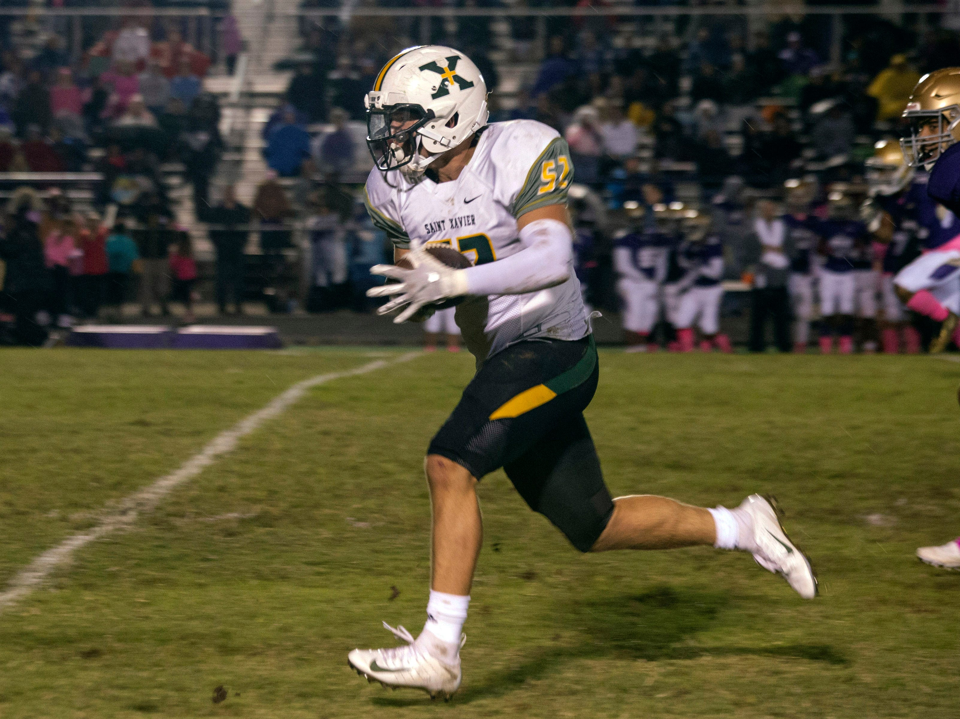 St. X defensive lineman Patrick Owen dashes 40 yards with an interception return for a touchdown against Male High on Friday night. Oct. 12, 2018