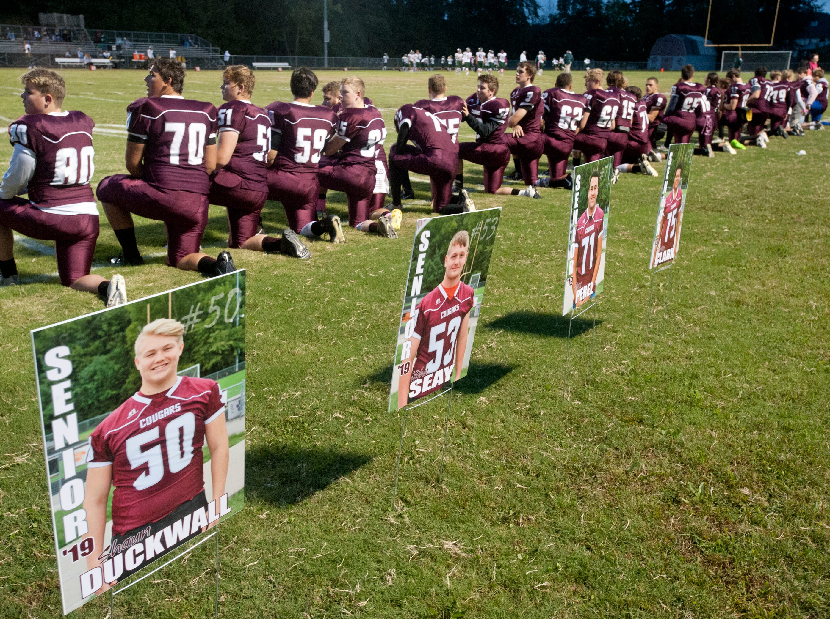"Posters of some of the Bullitt Central's  football squad decorates the sidelines during ""Seniors"" night. Oct. 12, 2018"