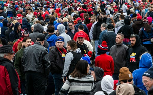 Hundreds of people waited in a parking lot outside the Alumni Coliseum for the speech of President Donald Trump later Saturday night.