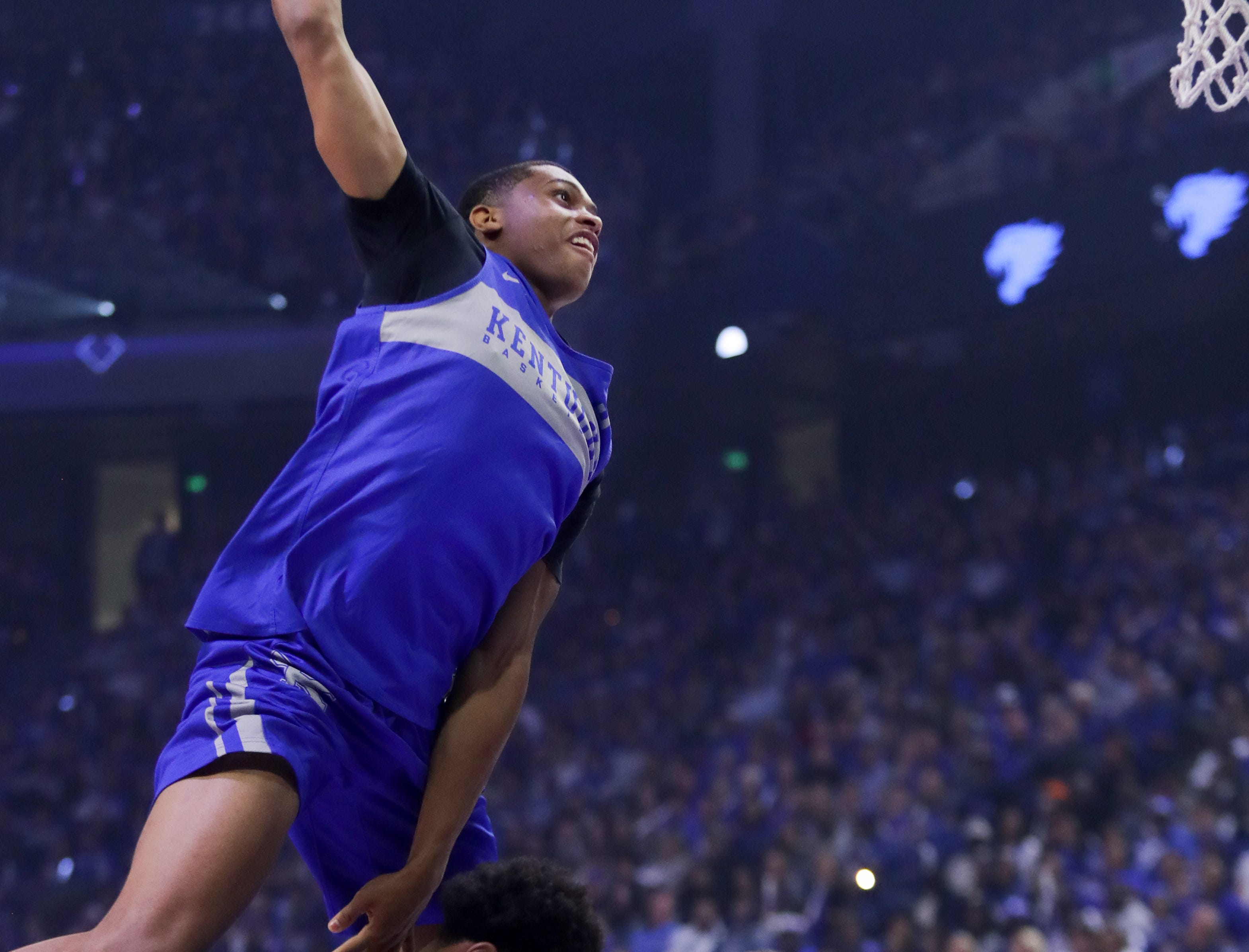 Kentucky Keldon Johnson leaps over two people during the dunk contest at Big Blue Madness in Lexington, Kentucky.
