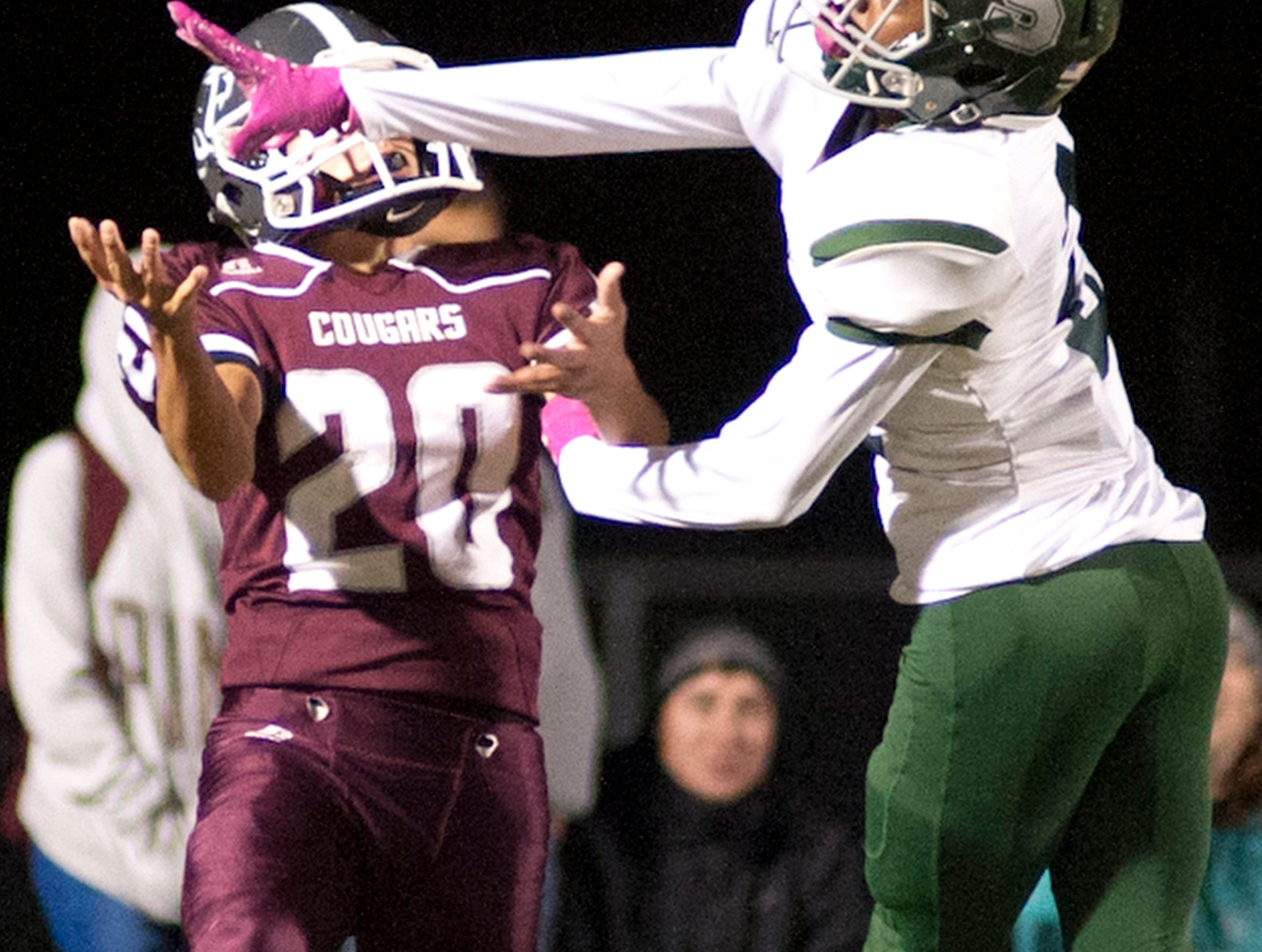 South Oldham defensive back Isaac Lalli brakes up a pass intended for Bullitt Central wide receiver Jacob Dillman. Oct. 12, 2018