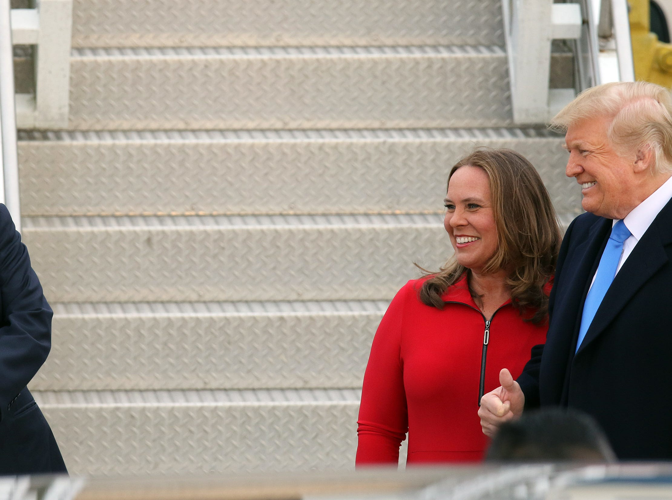 President Trump, right, poses with State Rep. Suzanne Miles (R-7th) as Gov. Matt Bevins takes a photo near Air Force One after arriving at Bluegrass Airport in Lexington, Oct. 13, 2018.
