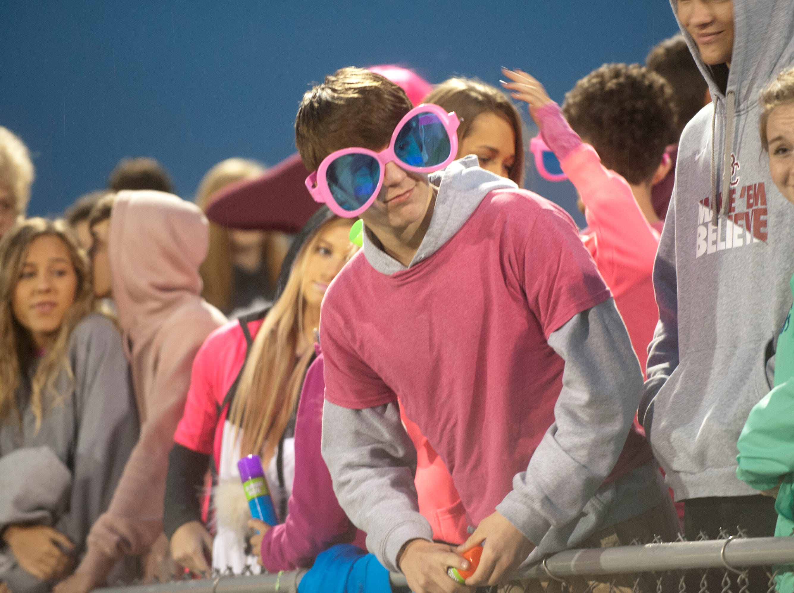 A Bullitt Central fan with oversize glasses checks out the action from the stands. Oct. 12, 2018