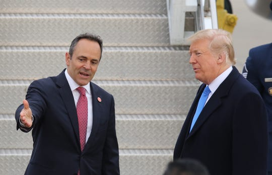 Kentucky Gov. Matt Bevin greets President Donald Trump as he lands in Lexington on Oct. 13, 2018.