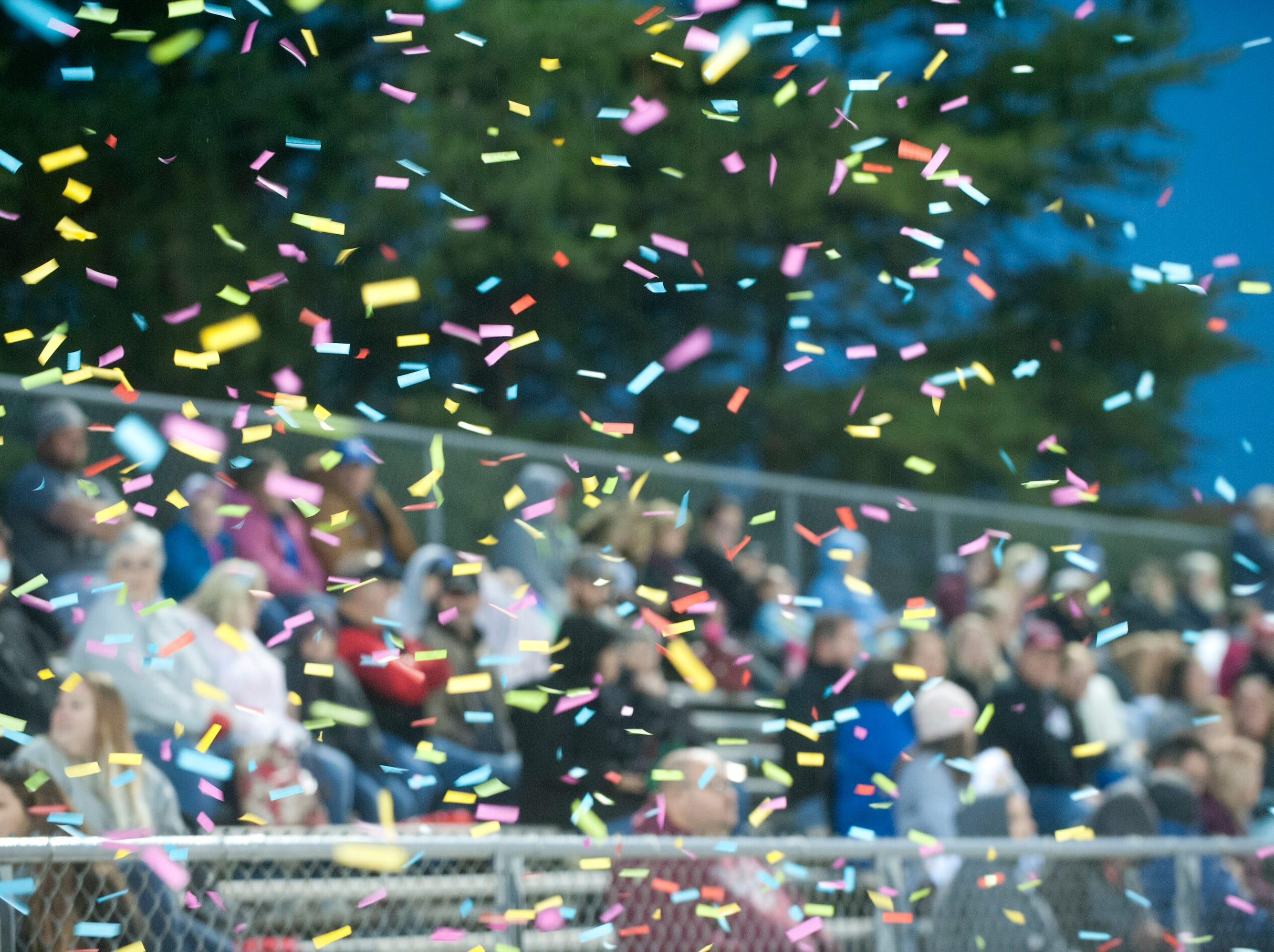 Confetti pours down from the Bullitt Central stands. Oct. 12, 2018