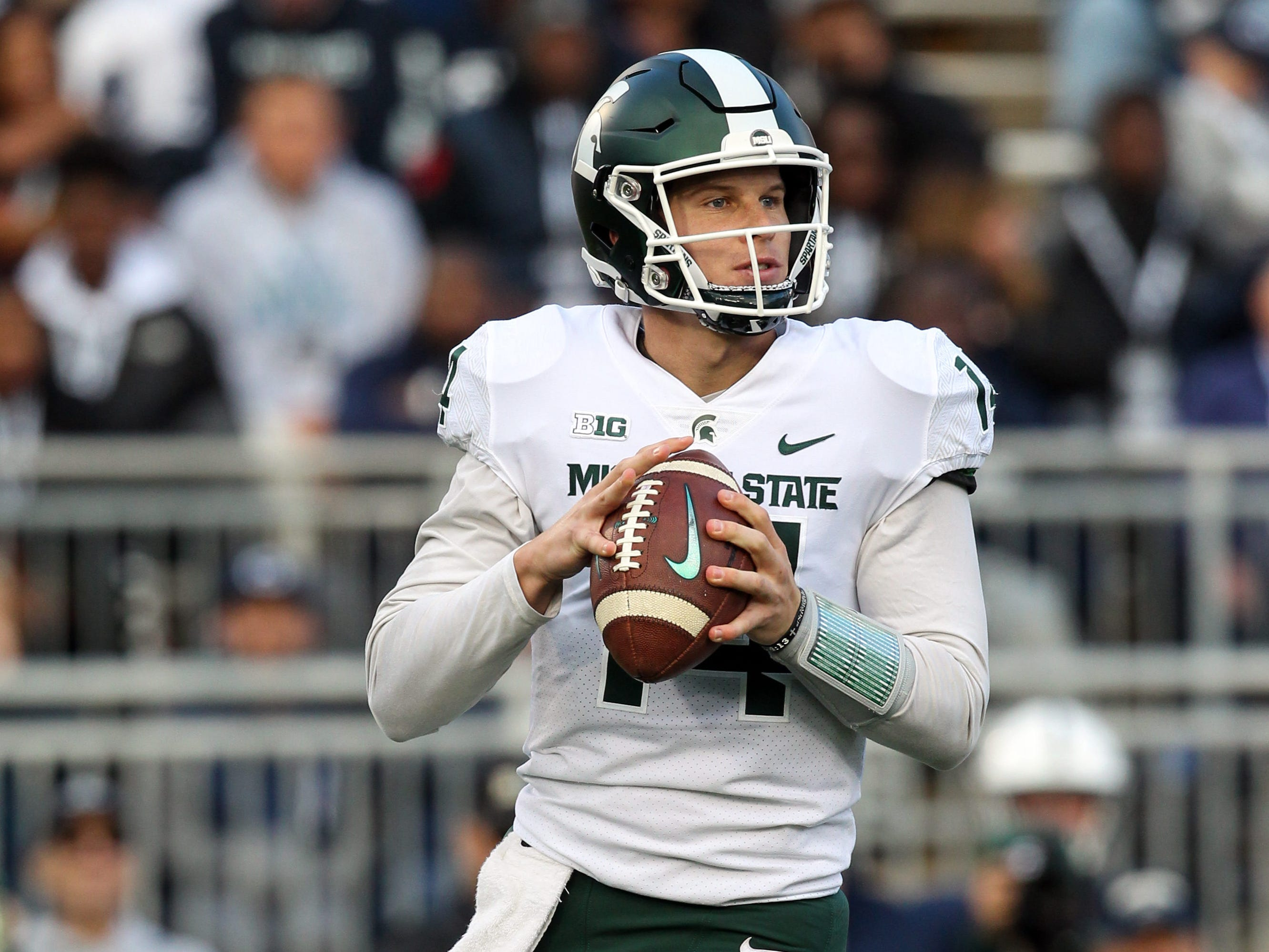Michigan State Spartans quarterback Brian Lewerke (14) drops back in the pocket during the first quarter against the Penn State Nittany Lions at Beaver Stadium.