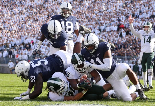 Penn State Nittany Lions linebacker Micah Parsons (11) tackles Michigan State Spartans running back La'Darius Jefferson (15) short of the goal line during the second quarter at Beaver Stadium.