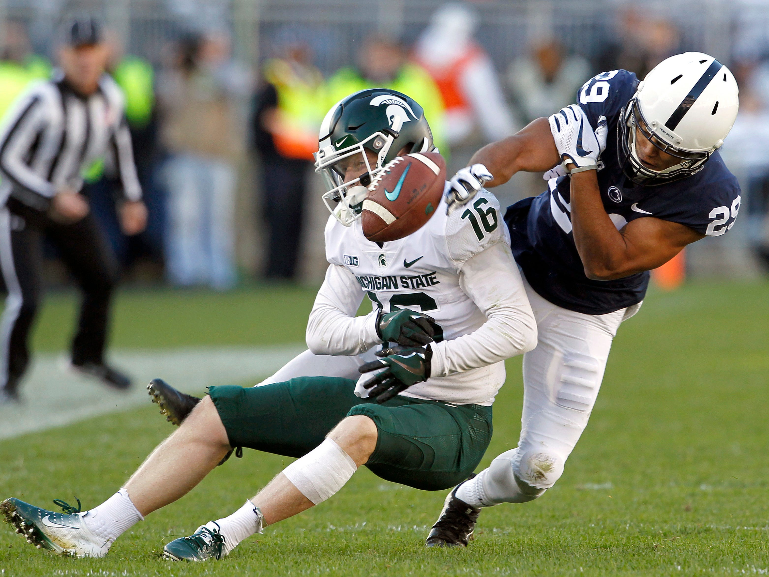 Penn State's John Reid (29) breaks up a pass intended for Michigan State's Brandon Sowards (16) during the first half of an NCAA college football game in State College, Pa., Saturday, Oct. 13, 2018.