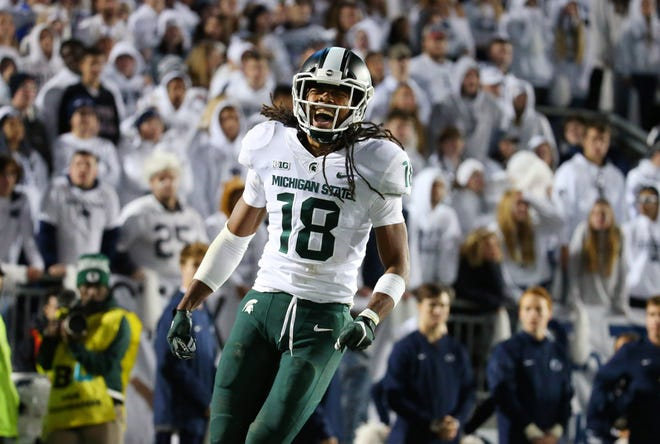 Michigan State Spartans wide receiver Felton Davis III (18) reacts after catching the winning touchdown pass against the Penn State Nittany Lions during the fourth quarter at Beaver Stadium.