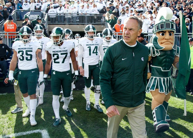 Michigan State Spartans head coach Mark Dantonio leads his team onto the field prior to the game against the Penn State Nittany Lions at Beaver Stadium.