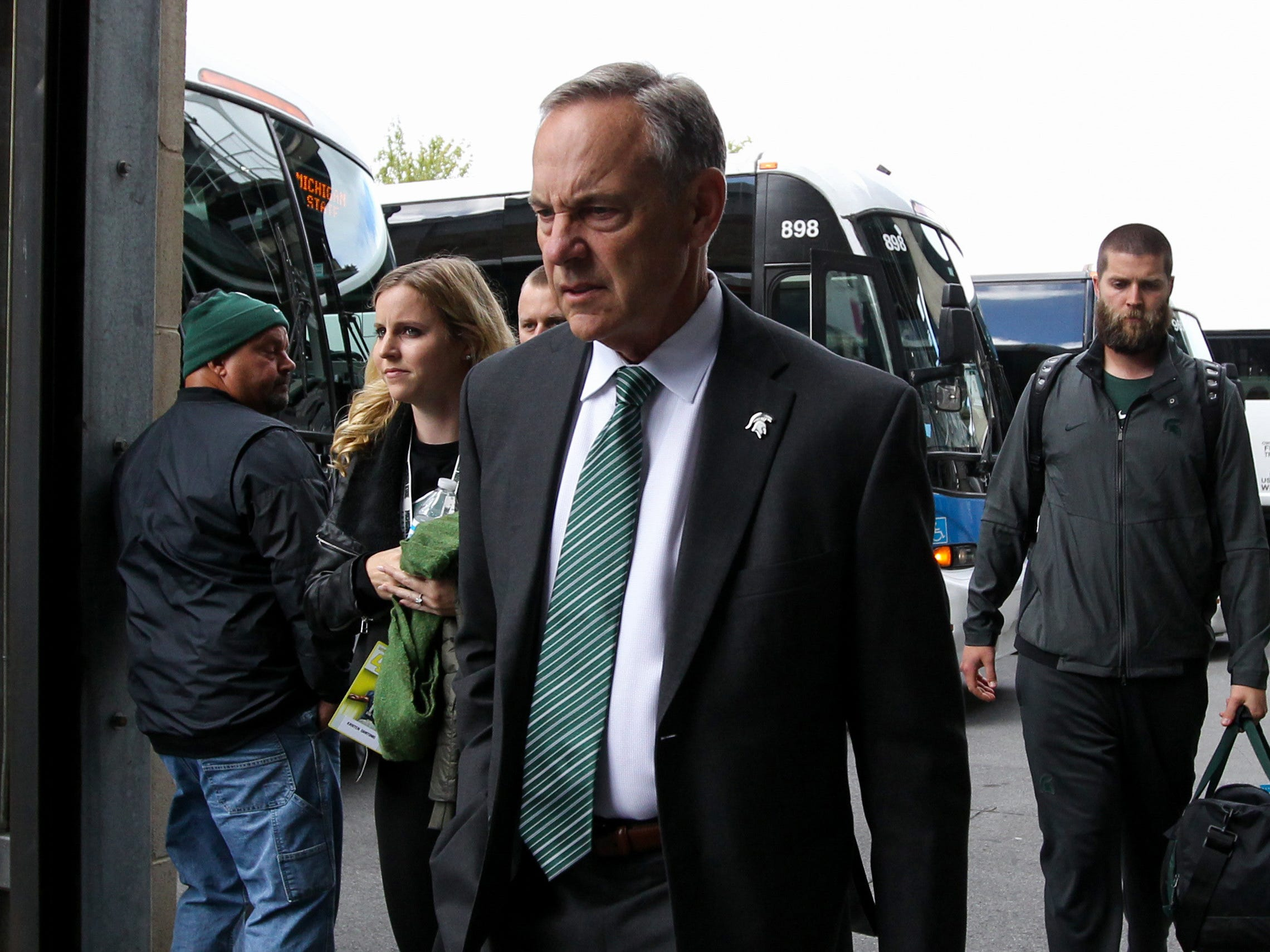 Michigan State Spartans head coach Mark Dantonio exits the team bus prior to the game against the Penn State Nittany Lions at Beaver Stadium.