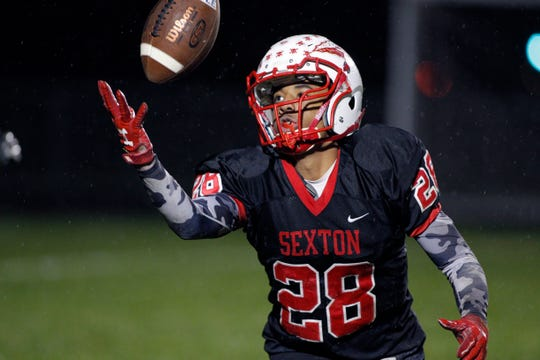 Sexton's Joshua Grier intercepts an Eastern pass and returns it for a touchdown, Friday, Oct. 12, 2018, in Lansing, Mich. Sexton won 27-8.