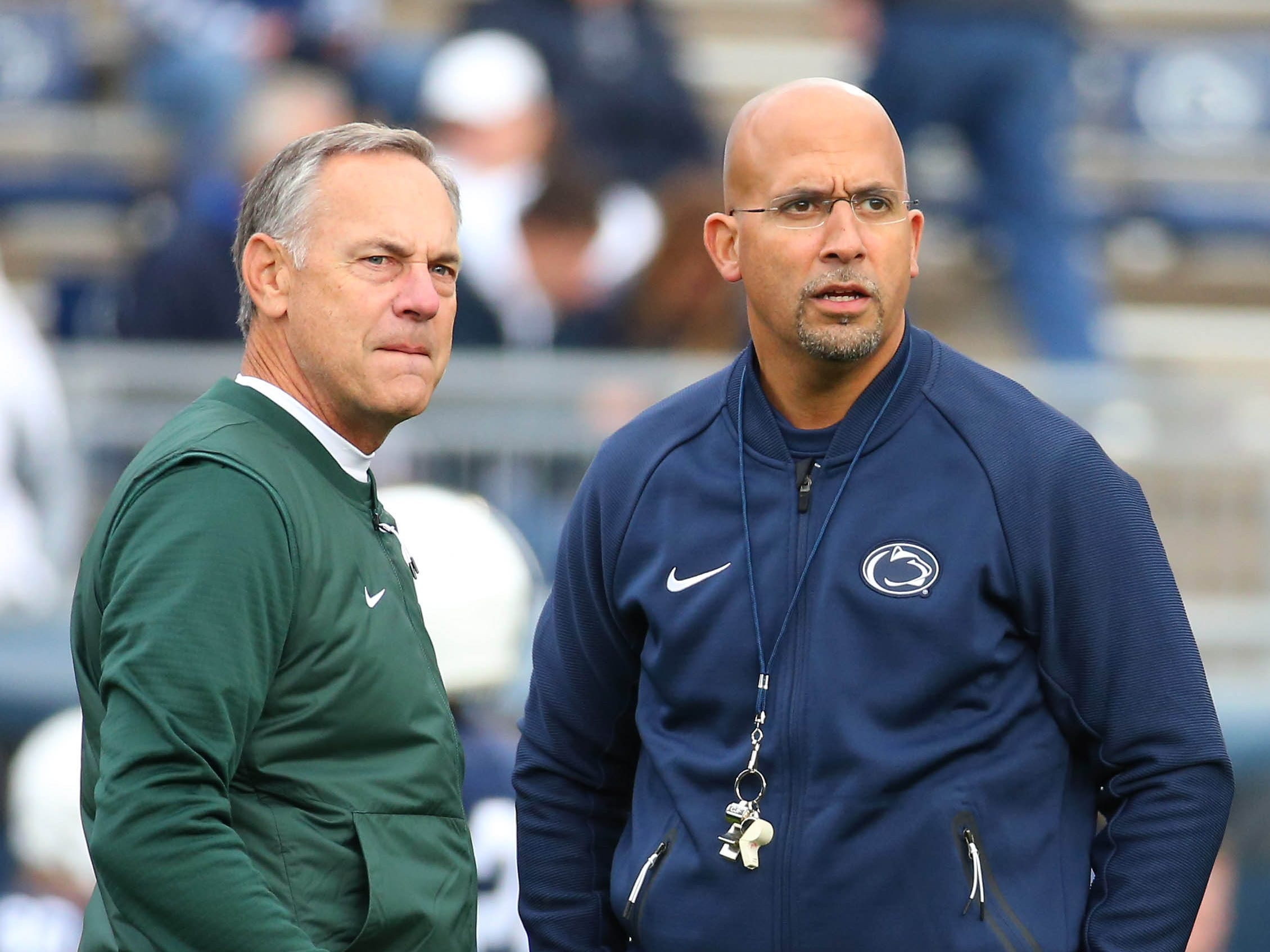 Michigan State Spartans head coach Mark Dantonio (left) and Penn State Nittany Lions head coach James Franklin (right) meet prior to the game at Beaver Stadium.