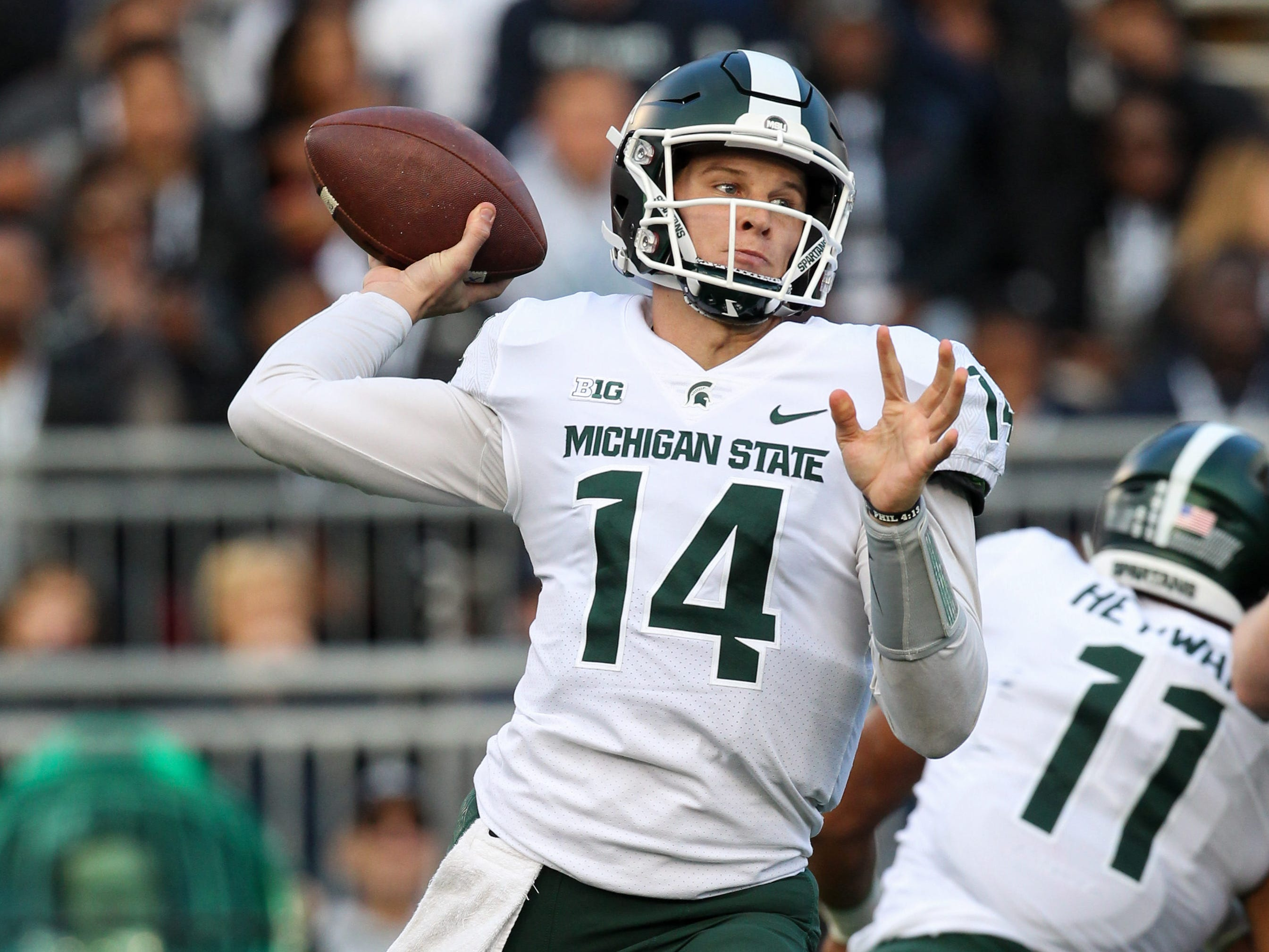 Michigan State Spartans quarterback Brian Lewerke (14) throws a pass during the first quarter against the Penn State Nittany Lions at Beaver Stadium.